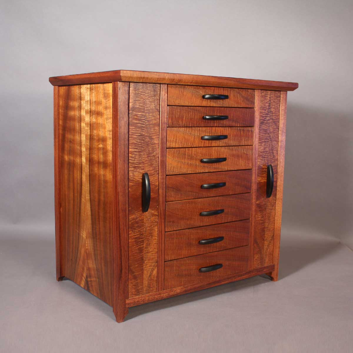 koa jewelry cabinet with necklace and earring storage